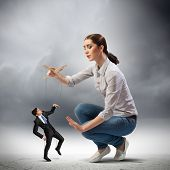 picture of male-domination  - Image of pretty businesswoman puppeteer - JPG