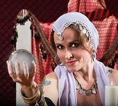 stock photo of seer  - Gorgeous female fortune teller holding a crystal ball - JPG