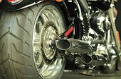 picture of street-rod  - Rear view of a shiny red motorcycle - JPG