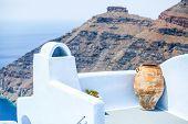 Ceramic Vase On The Balcony Background Of Cliff Scaros In Imerovigli, Santorini