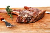 savory : grilled spare rib on wooden plate with thyme isolated over white background