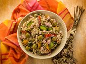 spelt salad with vegetables and ham,  selective focus