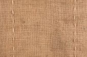 The Two Vertical Stitching On The Burlap