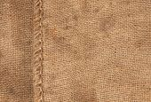 stock photo of sackcloth  - large seam on sackcloth can use as background - JPG