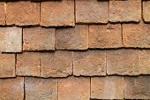 stock photo of tile cladding  - Close up of clay external wall tiles used to partially clad the outside of buildings  - JPG