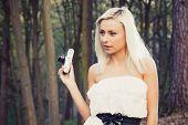 Beautiful adult girl with retro photo camera
