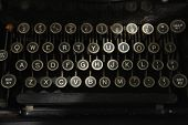 image of old vintage typewriter  - Stripe of light across keyboard of old antique typewriter - JPG
