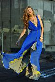 Fashion model posing sexy wearing long blue evening dress