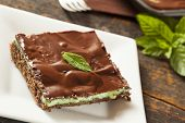 stock photo of brownie  - Homemade Chocolate and Mint Brownie Against a Background - JPG