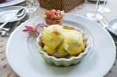 pic of columbine  - Eggs Benedict served with tomato salsa and a columbine flower - JPG