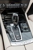 picture of gear-shifter  - automatic gear shifter in black dashboard inside sports luxury car - JPG