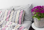 image of pillowcase  - Modern bedroom decorated with bright purple flowers - JPG