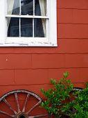 Wagon Wheels Against Building