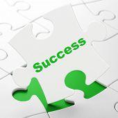 Business concept: Success on puzzle background