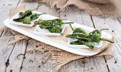 picture of pimiento  - Portion of fried Pimientos on vintage wooden background - JPG