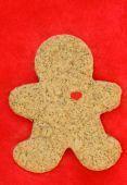 Gingerbread cookie on red fur background