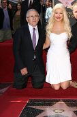 Christina Aguilera with Irving Azoff  at Christina Aguilera's induction into the Hollywood Walk of Fame, Hollywood Blvd, Hollywood, CA. 11-15-10