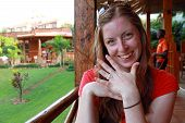 Smiling Woman With String Engagement Ring