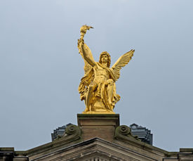 picture of flambeau  - Sitting golden angel on the top of historic house in Dresden - JPG