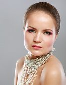 foto of bangles  - Portrait of pretty young woman with beads and bangle - JPG
