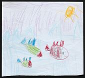 Original child's drawing of three fishes in a blue sea drawing by a five-year-old girl.
