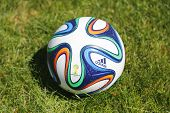 Brazuca soccer ball on grass
