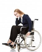 Sad, serious business woman sitting on wheelchair. Isolated on white.