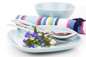 Tableware With Blue Lobelia Flowers And Cutlery, On A White Background.
