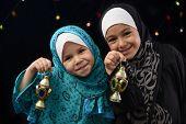 pic of muslim kids  - Happy Muslim Girls with Ramadan Lantern on Defocused Night Lights Background - JPG
