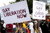 Two Participant Of Gay Pride Parade With Placards