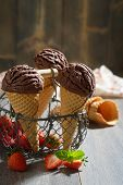 Chocolate icecreams in basket in rustic setting