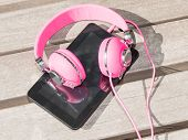 Female Pink Headphones And Tablet Pc