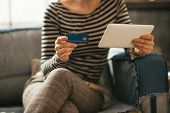 Closeup On Young Woman With Credit Card And Tablet Pc Sitting On