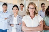 image of half-dressed  - Casual business team smiling at camera with arms crossed in the office - JPG