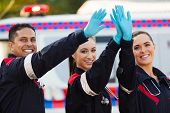 cheerful paramedic team high five