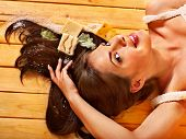 Young woman in sauna with soap. Healthy lifestyle.
