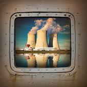 Nuclear power plant on the coast wiew from steel window. Ecology disaster concept.