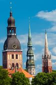 Three church towers in the picture are the Riga Dome cathedral,  St. Saviour's Church and St. Peter