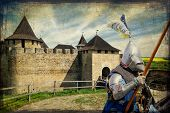 Armored Knight On Warhorse Over Old Medieval Castle