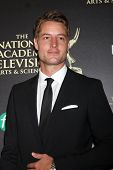 LOS ANGELES - JUN 22:  Justin Hartley at the 2014 Daytime Emmy Awards Arrivals at the Beverly Hilton