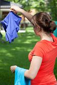 Young Mum Hanging The Laundry