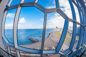 A fisheye view to Reykjavik coastline through the windows of modern building