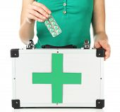 Woman holding first aid kit, isolated on white