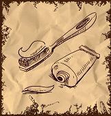 Toothpaste and brush on vintage background