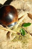 image of calabash  - Calabash and bombilla with yerba mate on burlap background - JPG
