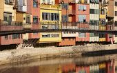 Spain. Catalonia. Girona. Onar Colorful Houses And Bridge.