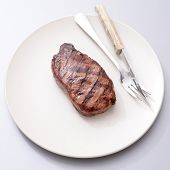 stock photo of porterhouse steak  - A close up shot of an Australian Porterhouse steak - JPG