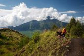 Group of hikers walking in the caldera of volcano of Batur, Bali, Indonesia