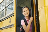 picture of pre-teen girl  - Pre teen girl getting on school bus - JPG