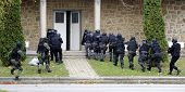 pic of anti-terrorism  - Special force police in action aiming guns - JPG